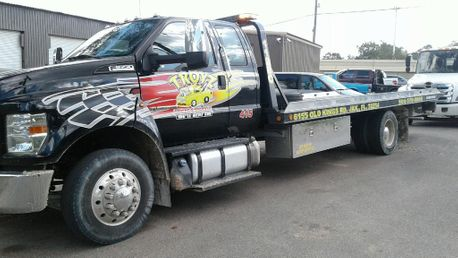 Yellow tow truck from towing services company Troyz Towing & Storage in Jacksonville, FL