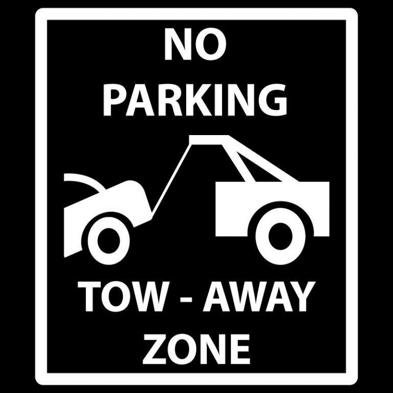 No parking tow away zone signage at a business serviced by Troyz Towing & Storage in Jacksonville, FL