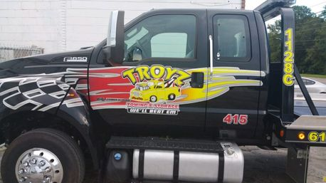 Towing company Troyz Towing & Storage tow truck parked outside of their Jacksonville, FL location