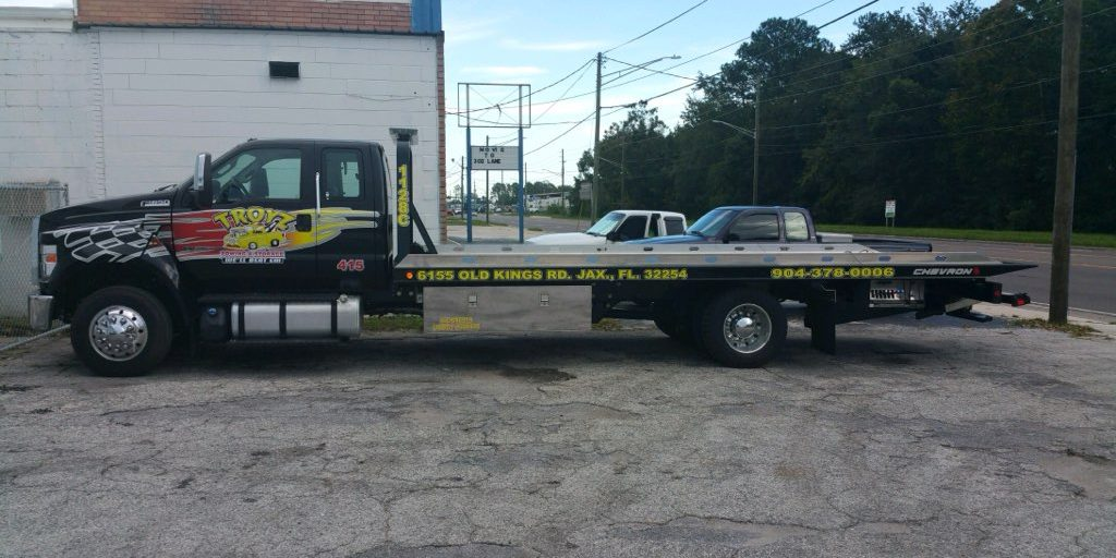 roadside assistance Towing company Troyz Towing & Storage tow truck parked outside of their Jacksonville, FL location